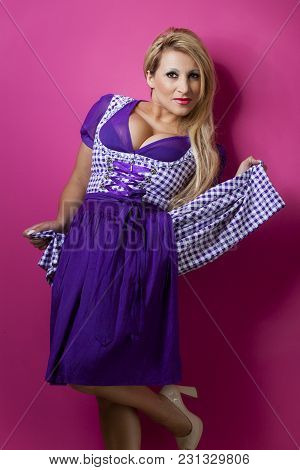 Bavarian Woman In A Dirndl On Pink