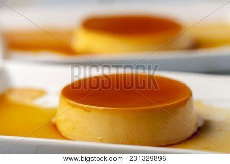 Closeup Of Flan Dessert On White Plates