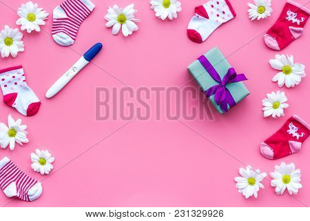 Joy Of Long-awaited Pregnancy. Pregnancy Test With Two Stripes Near Flowers On Pink Background Top V