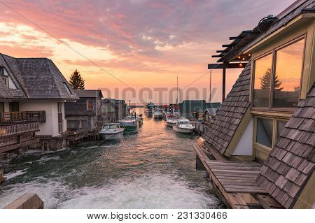 Leeland, Mi/usa - Sept 20 - A Vivid, Lake Michigan Sunset, Illuminates The Fishing Boats And Shacks