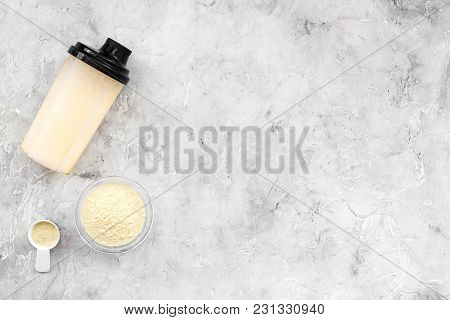 Protein Powder For Fitness Nutrition To Start Training On Gray Desk Background Top View Mock-up