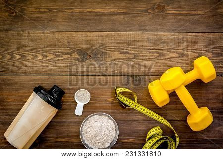 Nutrition For Workout With Protein Cocktail, Powder And Bars On Wooden Table Background Top View Moc
