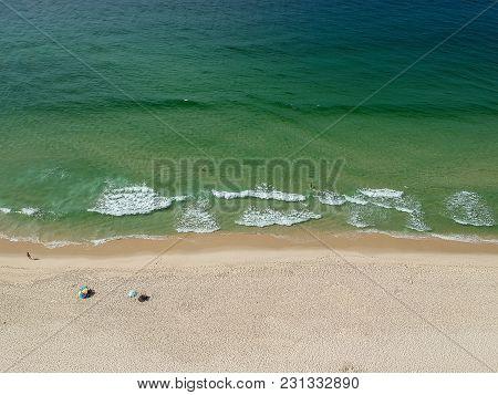 Drone Photo Of Barra Da Tijuca Beach, Rio De Janeiro, Brazil. We Can See A Relaxing View Of The Beac