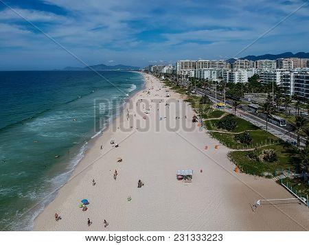 Drone Photo Of Barra Da Tijuca Beach, Rio De Janeiro, Brazil. We Can See The Beach, Some Building, T