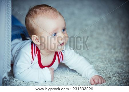 Childhood, Infancy, Newborn. Baby With Blue Eyes On Adorable Face. Child Development Concept. Infant