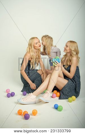 Child Small Boy And Twins Women, Relatives. Happy Family Play With Toy Balls. Love, Happiness, Paren