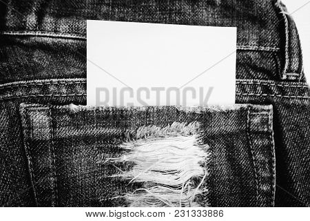 A Piece Of Paper In The Pocket Of Jeans Trousers. Close-up