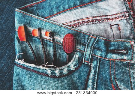 3402341 Professional Makeup Brushes On Denim Background. Women's Accessories.