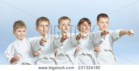 Five Children Hit A Punch On A Light Background