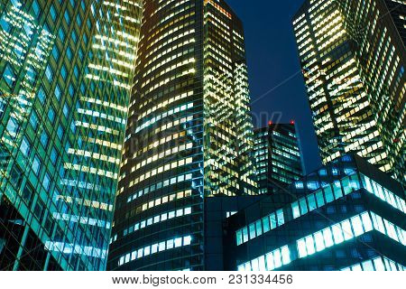 Illuminated Office Buildings In Paris Business District La Defense. Night City Lights, Skyscrapers G