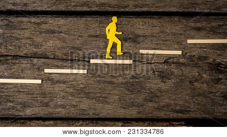 Yellow Silhouette Cutout Of A Person Climbing The Stairs Over Rustic Wood Towards Career.