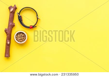 Acessories For The Grooming Of The Dog. Food And Toys For Dogs. Yellow Background Top View Mock-up.