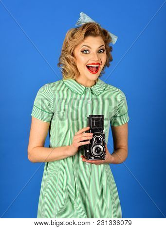Girl With Vintage Photo Camera. Pin Up Pretty Fashion Model Photographer. Woman With Retro Hair, Mak