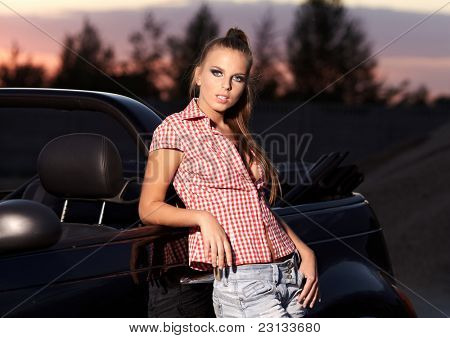 Beautiful woman on black  cabriolet