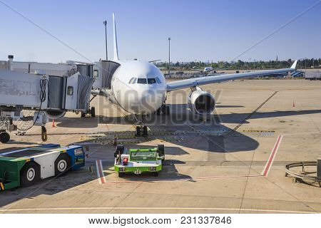 Preparing Aircraft For Flight. Servicing Of Aircraft At The Airport. The Plane In The Terminal Of Th