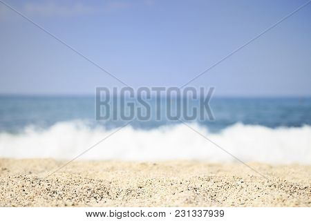 Sandy Sea Beach On Clear Summer Day. Selective Focus. Soft Waves Of Blue Sea On Tropical Beach With