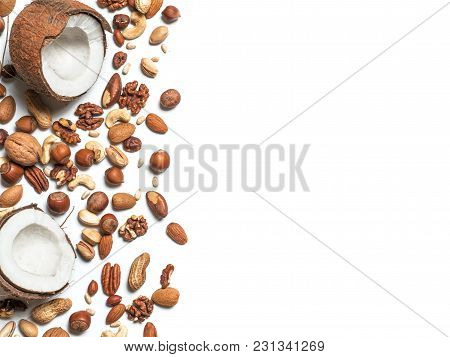 Background Of Mixed Nuts - Coconut, Hazelnuts, Walnuts, Almonds, Pecan, Pistachio, Brazil Nut, Pine