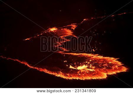 Molten Streams Of Red Fiery Lava Of The Volcano Erta Ale, Night Photography, The Afar Area In The No