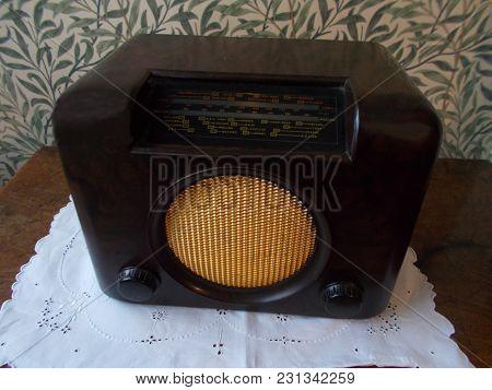 Antique Radio Or Old Fashioned Radio In A Dark Wood Case