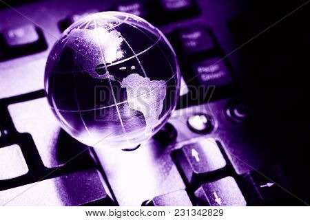 World Transparent Globe Earth On Computer Keyboard. Global Communications Business Concept. Ultravio