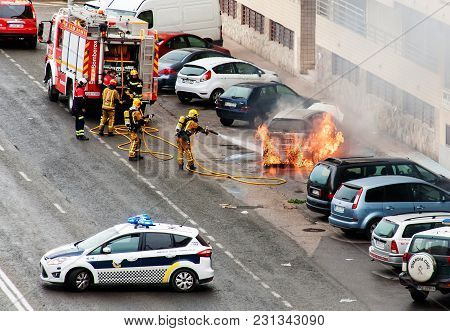 Fireman Fighting A Car Fire After A Road Accident.torrevieja/spain-march 15 2018