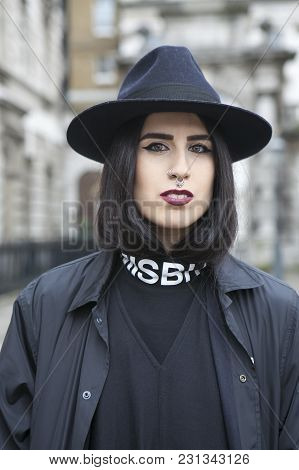 London - February 18: Stylish Women In Black Coat And Hat During London Fashion Week On February 18,