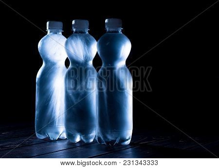Frozen Bottled Water. Black Backgroud Isolated. Macro