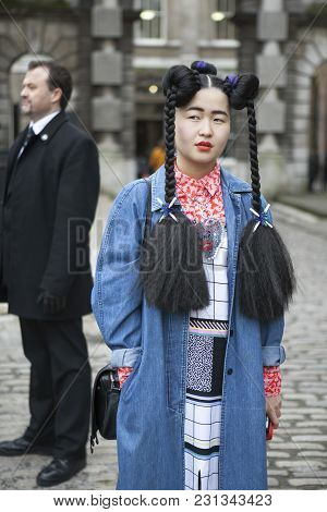 London - February 18: Stylish Woman In Blue Jean Clothes Coat During London Fashion Week On February