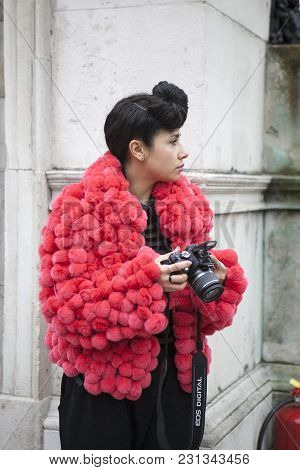 London - February 18: Brunette Woman Blogger In Red Furs Coat With Camera  Outside Somerset House Du