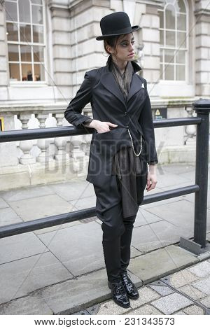 London - February 18: Stylish Woman In  Black Coat And Hat In Vintage Style  During London Fashion W