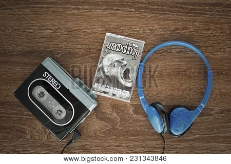 Vilnius, Lithuania - August 20, 2017: Vintage Walkman, The Prodigy Cassete And Headphones On The Woo