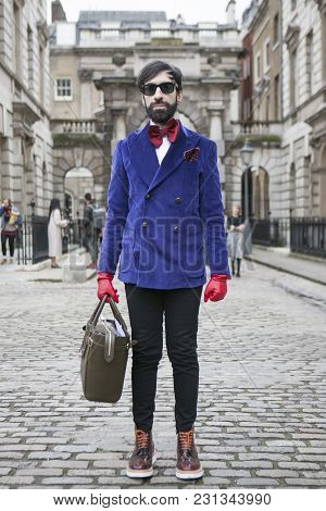 London - February 18: Laughing Man  Wearing Blue Suit With Red Gloves Poses For Photographers With S