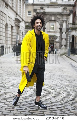 London - February 18: Laughing Man  Wearing Yellow Coat And Dreads Poses For Photographers With Silv