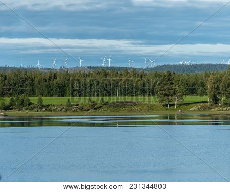 Wind Turbines, Green Forest And Lake, Blattnicksele, Sweden
