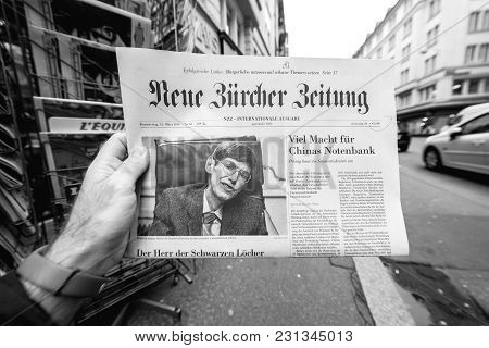 Paris, France - Mar 15, 2018: German Neue Burcher Zeitung Newspaper With Portrait Of Stephen Hawking