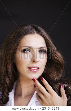 Beautiful Woman In White Shirt On The Studio Shoot On Dark Background