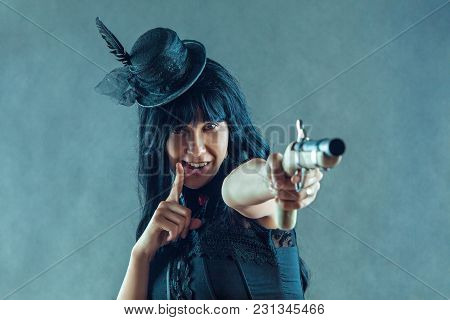 Wild West. Female Portrait Of Cowgirl With Vintage Pistol