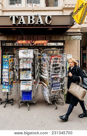 Paris, France - Mar 15, 2018: Senior Man Buying French Newspaper Liberation At Parisian Press Kiosk