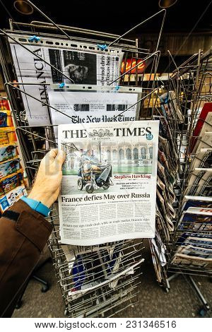 Paris, France - Mar 15, 2018: Hand Holding British Newspaper The Times With Portrait Of Stephen Hawk
