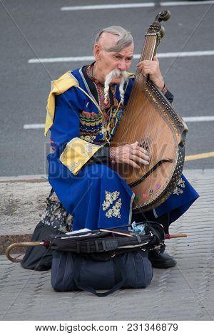 Kiev, Ukraine - June 19, 2016: Elderly Kobzar In A National Costume Plays A Kobza On The Street