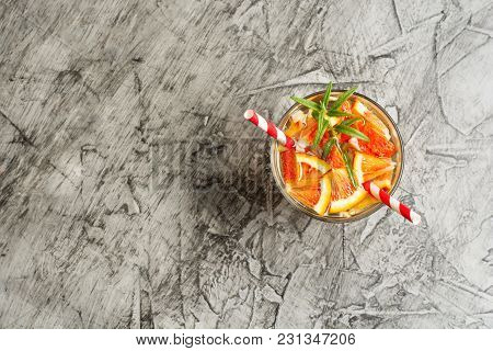 Cold Refreshing Summer Lemonade In A Glass On A Grey Concrete Or Stone Background .