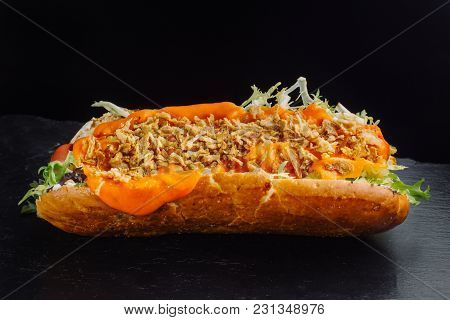 Danish Hot Dogs On Black Slate. Side View.