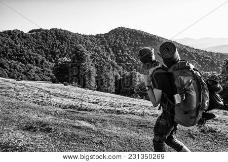 A Soldier With A Backpack Is Walking In The Mountains