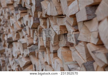 Material For Heating The House. Preparation Of Firewood For The Winter. Background Of Firewood. A Pi