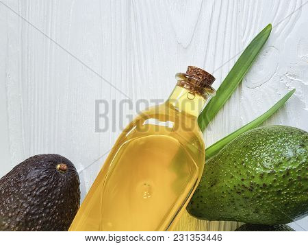 avocado oil on white wooden background avocado oil, manicure, ripe, ingredient, nutritious, half poster