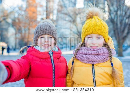 Adorable Little Girls Have Fun In Central Park At New York City