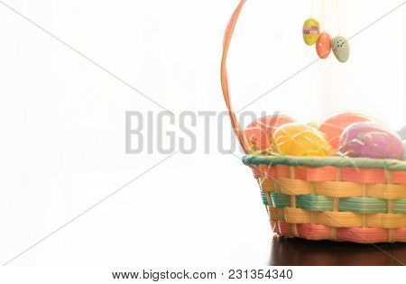 This Easter Basket Is Filled With Easter Eggs And Is Set In Front Of A White Background. Three Decor