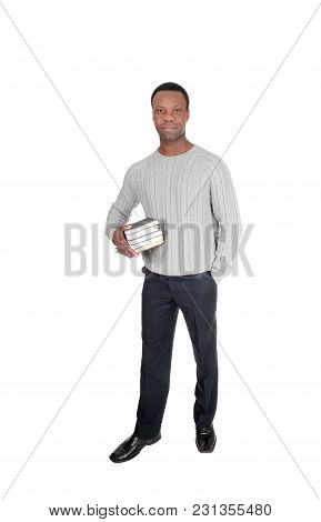 A Handsome Serious Young African American Man Standing And Holding His Books His Books In His Hands,