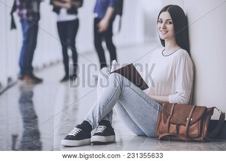 Female Beauty Young Student Reading A Book.