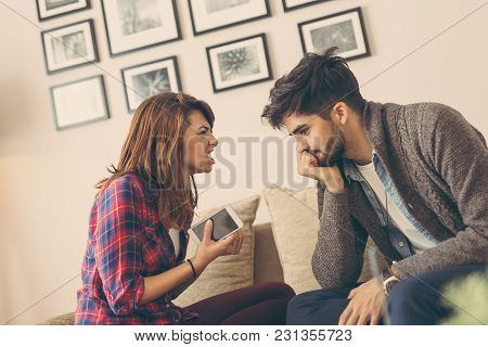 Young Couple Having A Heated Argument. Focus On The Girl